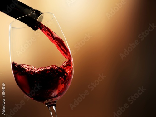 Valokuva Pour red wine on blurred background
