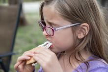 Young Girl Eating Gooey Marshmallow Smoke