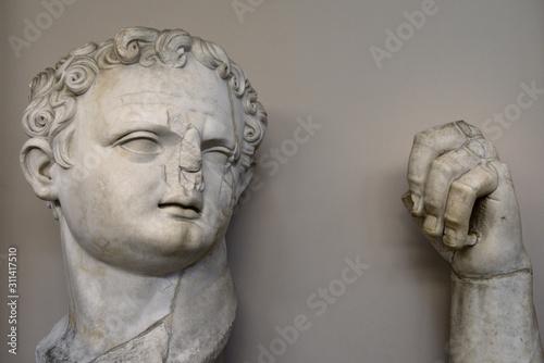 Fotografia, Obraz Ruined sculpture of head and hand of Roman Emperor Domitian at Ephesus Museum Tu