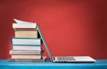 Stack Of Books With Laptop On ...