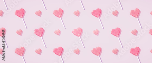 Pastel pink Flat lay heart shape lollipop on stick pattern Valentine day background Poster Mural XXL