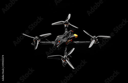 Modern FPV drone on a black background Fototapet