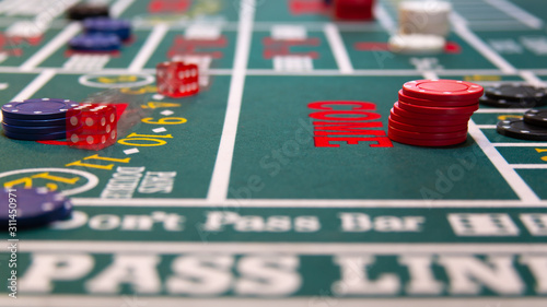 casino craps table with chips and dice Wallpaper Mural