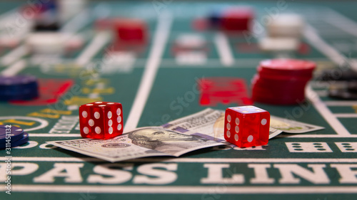 casino craps table with chips, cash, and dice Canvas Print