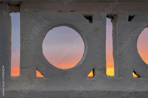 Photo banister with sunset at the background