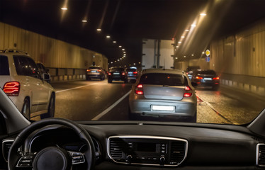 View from the car through the windshield of traffic in a tunnel