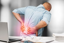 Businessman With Back Pain An ...