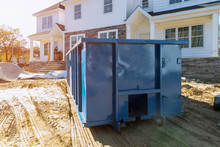 Blu Dumpster, Recycle Waste And Garbage Bins Near New Construction Site Of Appartment Houses Building