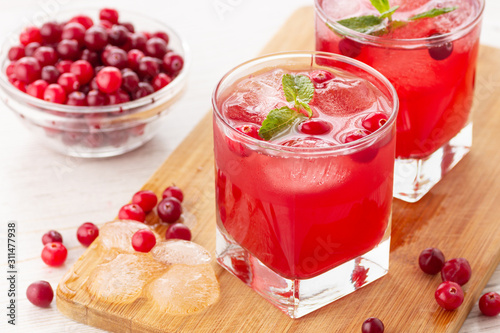 Fototapety, obrazy: Red coctail with cranberry, vodka and ice. Refreshment drink.