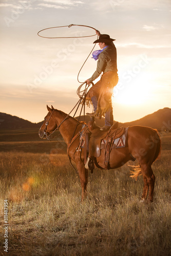 Standing on horse with rope Canvas Print