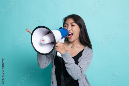 Beautiful young Asian woman announce with megaphone. Canvas Print