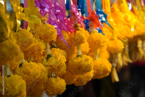Garlands of colorful Thai flowers on the roadside Wallpaper Mural