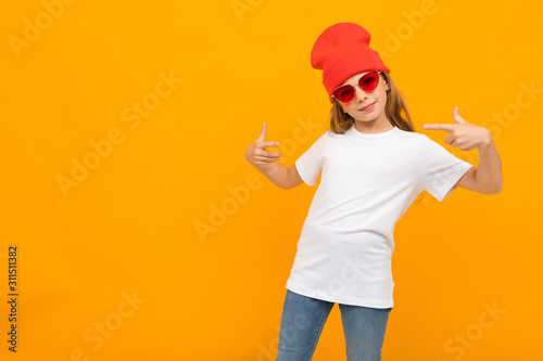 girl in a red hat and glasses in a T-shirt with mockup on a yellow background