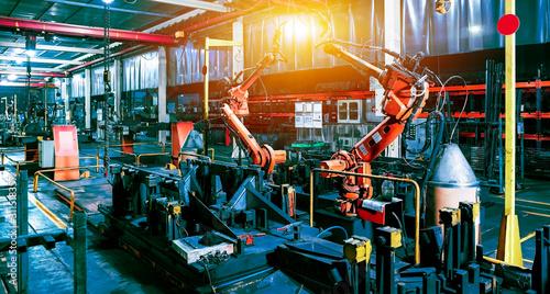 Fototapeta Large factory robot is operating an assembly line job obraz