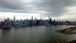 Epic Motionlapse (timelapse) of NYC panning from Brooklyn over East River to Manhattan Skyline. Empire State, chrysler building, United Nations, Sunrise to sunset, with clouds and boats.
