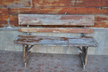 Old Wooden Bench On The Wall.