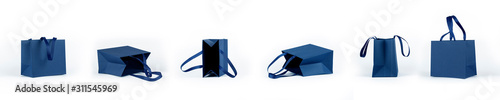 Photo Banner from empty gift paper bags, shopping bag in classic blue color isolated on white background