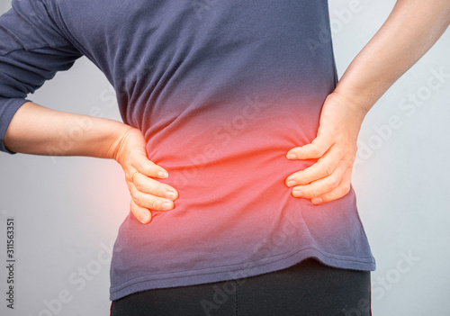 Cuadros en Lienzo  Woman caught at the waist and her back from chronic pain and suffering from back pain