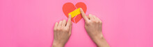 Cropped View Of Woman Putting Patch On Broken Paper Heart Isolated On Pink Background, Panoramic Shot