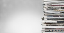 Pile Of Newspapers On White Ba...