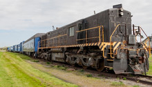 Old Diesel Locomotive With Tra...