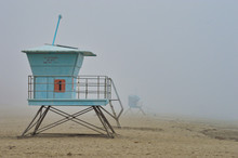 Lifeguards Towers On The Beach During Foggy Weather In Santa Cruz, CA
