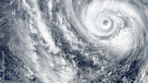 Fototapeta Eye of the Hurricane. Hurricane on Earth. Typhoon over planet Earth.. Category 5 super typhoon approaching the coast. View from outer space. (Elements of this image furnished by NASA) obraz