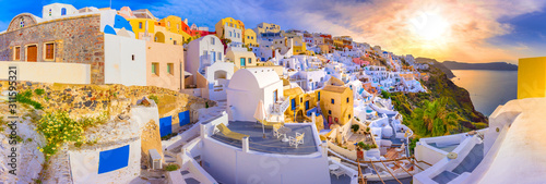 Fototapeta Oia town on Santorini island, Greece. Traditional and famous houses and churches with blue domes over the Caldera, Aegean sea obraz