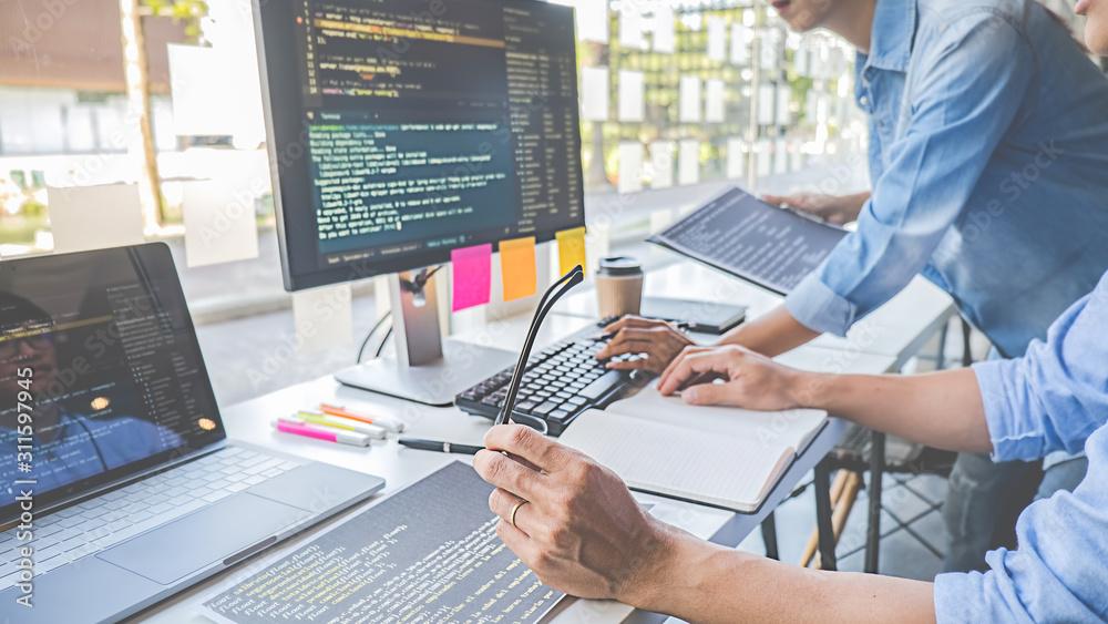 Fototapeta Programmer working in a software development and coding technologies. Website design. Technology concept.