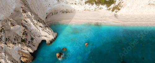 Aerial drone ultra wide photo of paradise white bay with turquoise clear sea in island of Kefalonia, Ionian, Greece