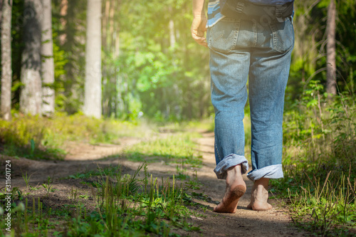 Man walking in forest Canvas Print