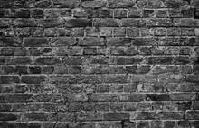 Horizontal Part Of Black Painted Brick Wall. Grey Stone Wall