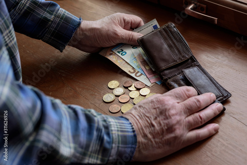 Photo The hands of an old man and counting money, euros