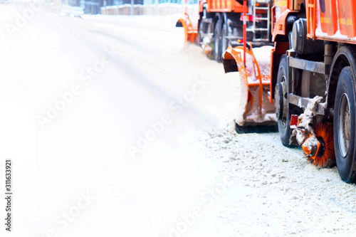 Snow plough trucks clearing road during winter snowstorm blizzard Wallpaper Mural