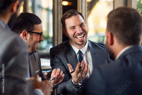 Fototapeta Successful and handsome business people discussing obraz