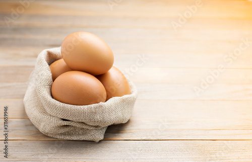 Fotomural Fresh eggs from the farm placed on an old wooden table with copy space
