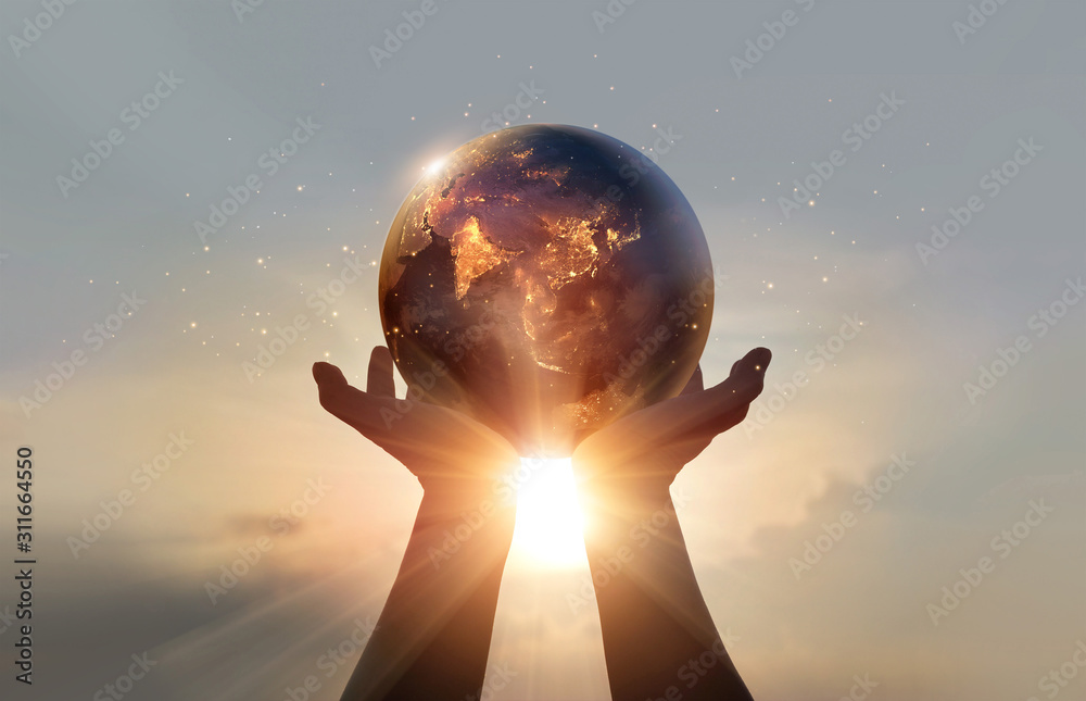 Fototapeta Earth at night was holding in human hands. Earth day. Energy saving concept, Elements of this image furnished by NASA