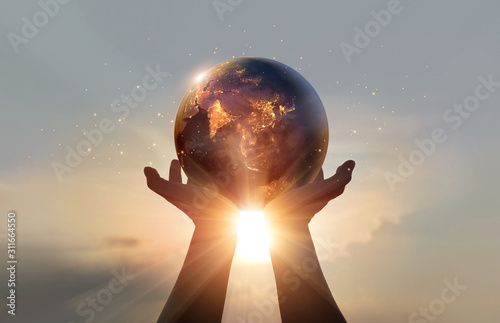 Earth at night was holding in human hands. Earth day. Energy saving concept, Elements of this image furnished by NASA #311664550