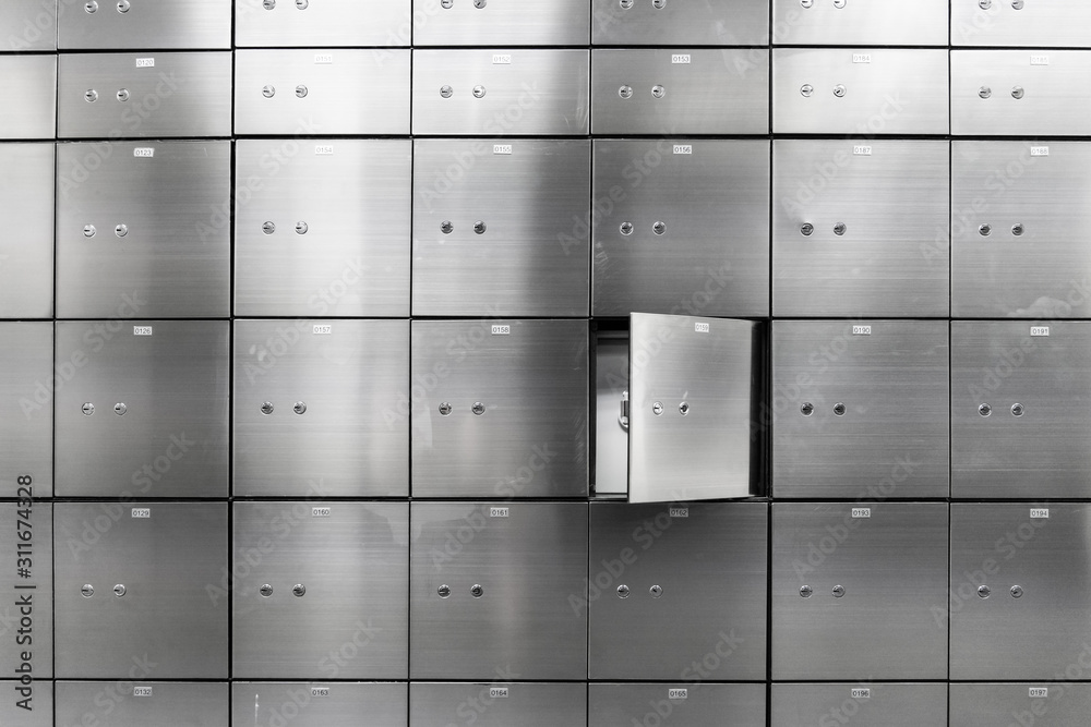 Fototapeta Metal safe box panel wall with open one. Concept for sucurity and banking protection.