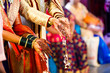 canvas print picture - Indian traditional wedding ceremony bridal and groom hand