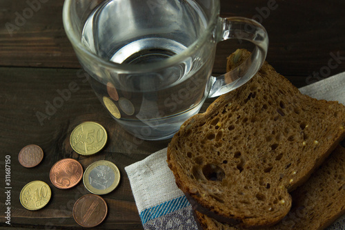 Bread and water for the last money Wallpaper Mural