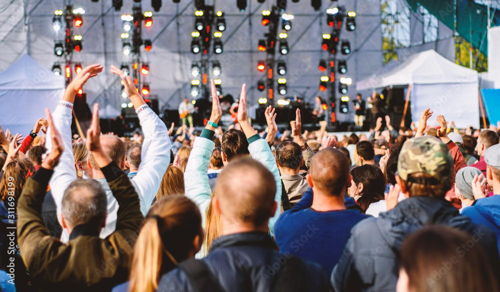 Fotografie, Obraz many different people at a concert listening to rock band music open air
