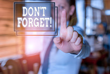 Writing Note Showing Don T Forget. Business Concept For Used To Remind Someone About Important Fact Or Detail Blurred Woman In The Background Pointing With Finger In Empty Space