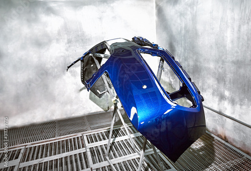Preparation and painting of car parts after an accident. Canvas Print
