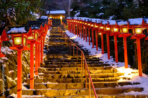 The lantern-lined steps in winter snow in Kibune at night Canvas Print