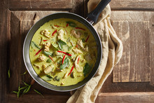 Thai Food Chicken Green Curry On Wooden Background. .