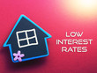 canvas print picture - LOW INTEREST RATE written on red background with wooden house