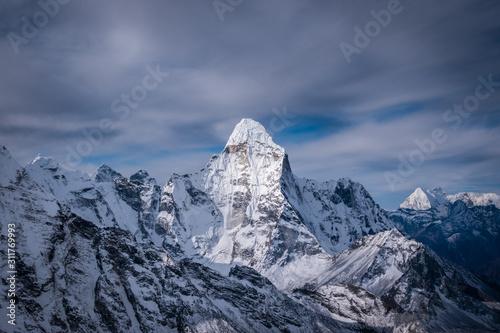 Obraz na plátně  Ama Dablam Mountain, Himalaya. Nepal. Blue Sky and Clouds