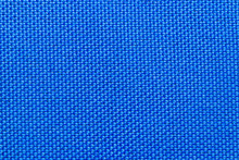 Close-up Of Blue Nylon Fabric Background Texture. Sturdy Woven Fabric For Sports Equipment Or Backpacks. Macro Photograph.