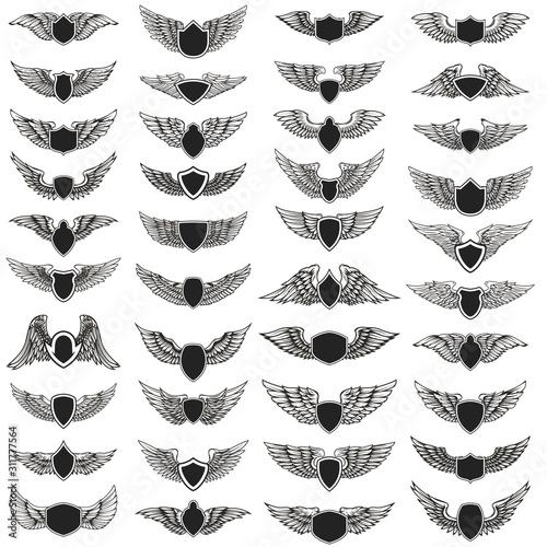 Set of emblems with wings. Design element for logo, label, emblem, sign, badge. Vector illustration Wall mural